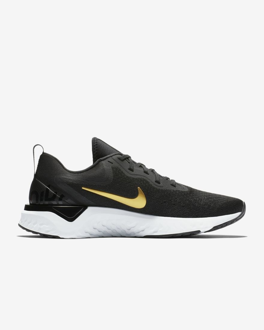Nike Lady Odyssey React in Schwarz Gold